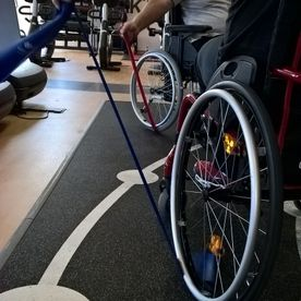 Wheelchair users doing exercises with resistance bands